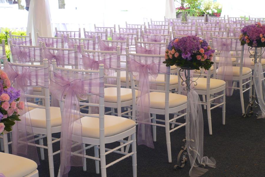 Lavender Organza Sashes Tied Onto Chiavari Chairs.